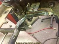 Reinforced rear frame tab for passenger pegs and muffler hangers